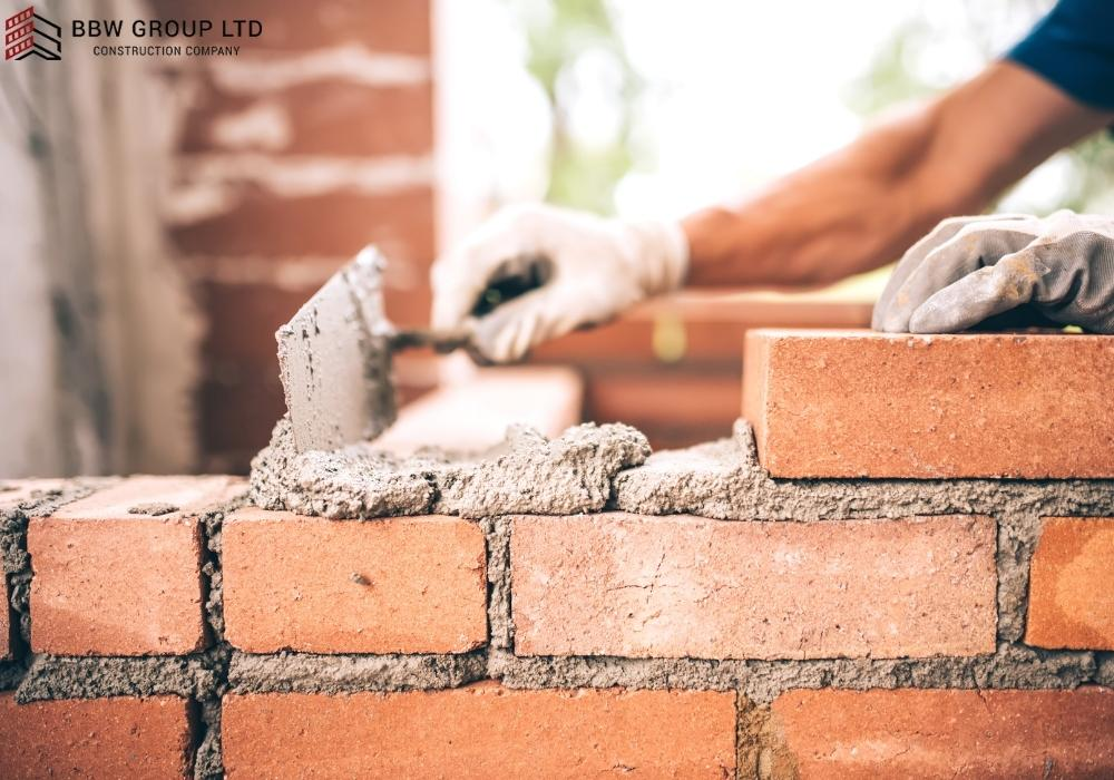 Can I build a brick wall on a concrete slab?