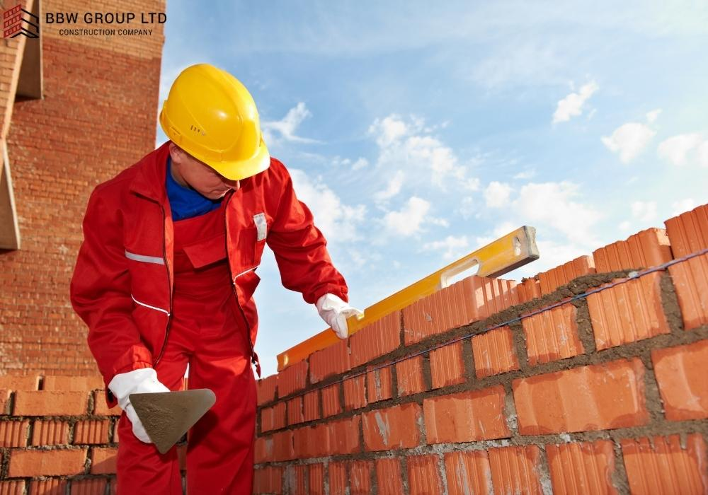 What is the hourly rate for a bricklayer?